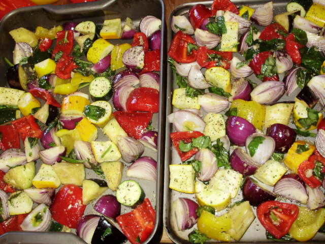 10. Divide veg evenly between the hot trays, without crowding, season with salt & black pepper