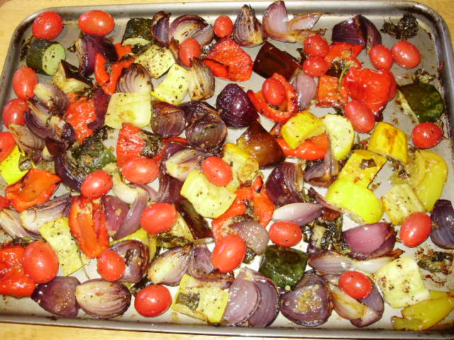 12b. Lightly coat tomatoes with oil, season & add to trays, return to oven