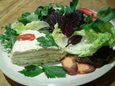3. Smoked Salmon & Watercress layered wrap cake slice served with salad