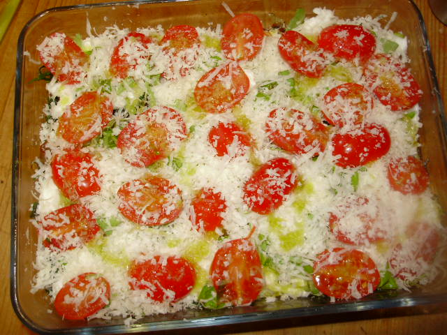 8. Scatter marjoram or oregano & halved tomatoes on top & sprinkle with grated Parmesan