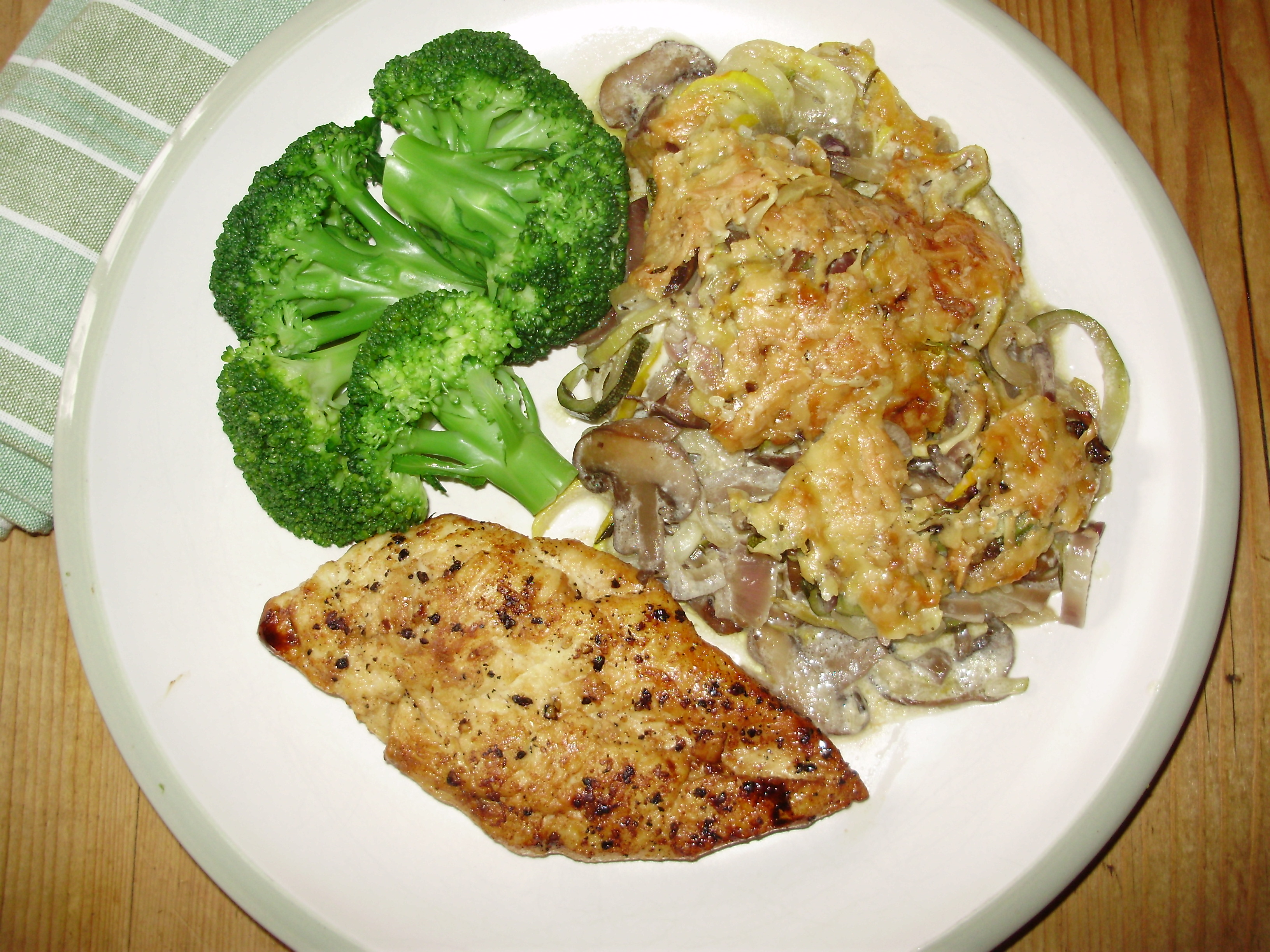 Creamy courgette & mushroom gratin served with black pepper chicken breast & broccoli